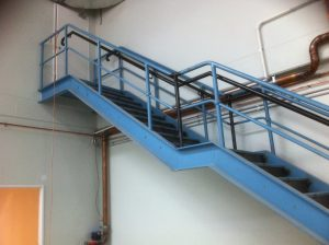 Metal stairs with handrail